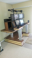 actuating height adjustable computer desk